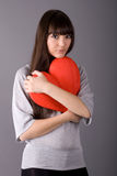 Beautiful woman holding red heart Stock Images