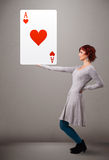 Beautiful woman holding red heart ace Royalty Free Stock Images