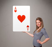 Beautiful woman holding a red heart ace Royalty Free Stock Images