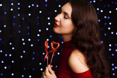 Beautiful woman holding red hearts Royalty Free Stock Photography