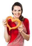 Beautiful woman holding red love heart. Royalty Free Stock Image