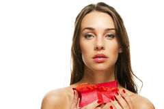 Beautiful woman holding red present Stock Images