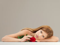 Beautiful woman holding a red rose Royalty Free Stock Images