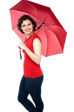 Beautiful woman holding a red umbrella Royalty Free Stock Image