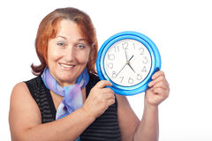 Beautiful woman holding a round clock Stock Images