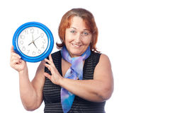 Beautiful woman holding a round clock Royalty Free Stock Images