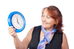 Beautiful woman holding a round clock Stock Image
