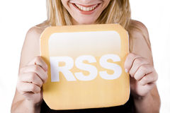 Beautiful woman holding rss logo Royalty Free Stock Images