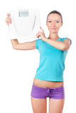Beautiful woman holding scale Stock Photo