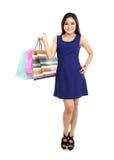 Beautiful woman holding shopping bags Stock Photography