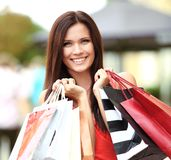 Beautiful woman holding shopping bags Stock Photo