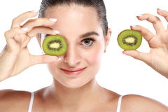 Beautiful woman holding and showing slices of kiwi Royalty Free Stock Photography