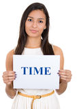 Beautiful woman holding a sign which says time Royalty Free Stock Image
