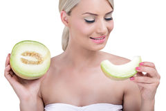 Beautiful woman holding a slice of melon Stock Image