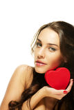Beautiful woman holding small red heart Stock Photo