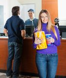Beautiful Woman Holding Snacks While Man Buying Royalty Free Stock Images