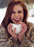 Beautiful woman holding snow heart Royalty Free Stock Photo