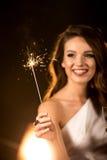 Beautiful woman holding sparkler Stock Photos