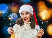 Beautiful woman holding sparkles. Royalty Free Stock Photography
