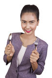 Beautiful woman holding a spoon and fork. Royalty Free Stock Images