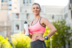 A beautiful woman holding a sports bottle of water Royalty Free Stock Photo