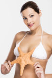 Beautiful woman holding a starfish Royalty Free Stock Photos
