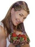 Beautiful woman holding strawberries. Beautiful woman holding up strawberries, wearing a cute head scarf Royalty Free Stock Image