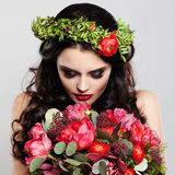 Beautiful Woman holding Summer Flower Royalty Free Stock Image