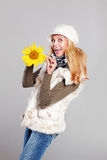 Beautiful woman holding a sunflower Royalty Free Stock Photos