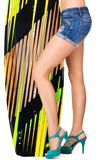Beautiful woman holding surfing board Stock Photo