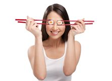 Beautiful woman holding sushi with a chopsticks Royalty Free Stock Image