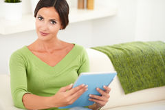 Beautiful woman holding a tablet indoors Royalty Free Stock Photos