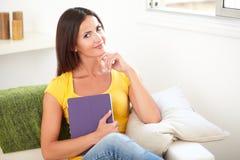 Beautiful woman holding a tablet indoors Stock Photos
