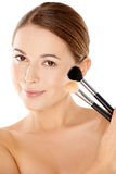 Beautiful woman holding two cosmetic brushes Royalty Free Stock Photography