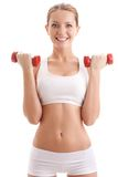 Beautiful woman holding two dumbbells Royalty Free Stock Photos