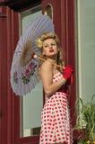 Beautiful woman holding an umbrella Stock Photography