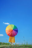 Beautiful woman holding umbrella and blue sky Stock Photography