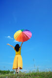 Beautiful woman holding umbrella and blue sky Stock Images