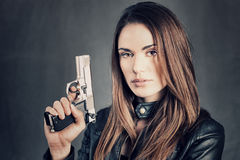 Woman holding up her gun Royalty Free Stock Image