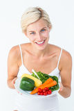 Beautiful woman holding vegetables plate Royalty Free Stock Images