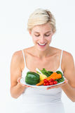 Beautiful woman holding vegetables plate Royalty Free Stock Photography