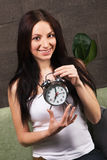 Beautiful woman holding vintage clock Royalty Free Stock Image