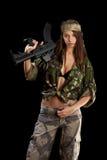 Beautiful woman holding weapon Royalty Free Stock Image