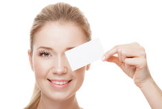 Beautiful woman holding white card with copy space.  Isolated. Stock Image
