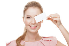Beautiful woman holding white card with copy space.  Isolated. Beautiful woman holding white card with copy space.  Isolated On White Background Stock Photography
