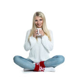 Beautiful woman holding white cup Stock Images