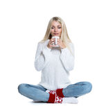 Beautiful woman holding white cup Stock Photo