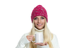 Beautiful woman holding white cup Stock Photos