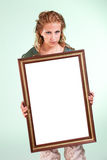 Beautiful woman holding a white decorative frame Stock Photos