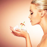Beautiful  woman holding  a white lily at face Stock Photo